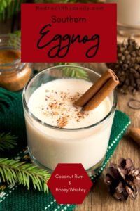 Glass of Southern Redneck Eggnog ready to drink displayed with Christmas decorations.