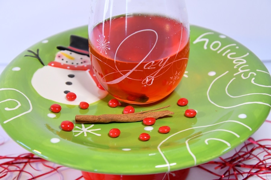 Glass of Southern Deck the Halls on a serving plate.