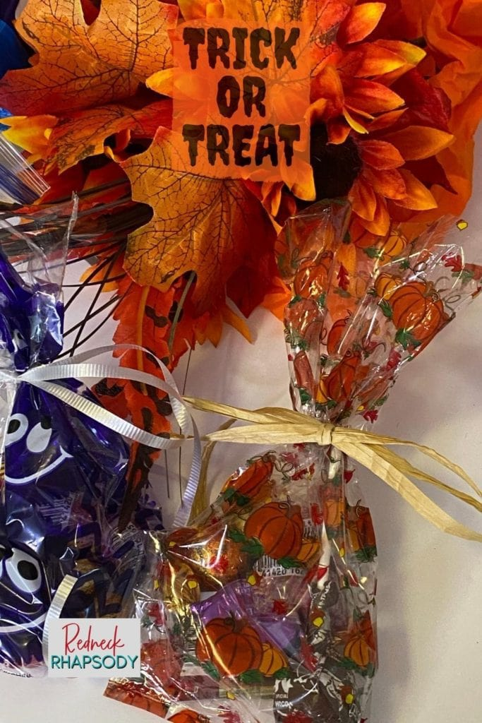 Candy in decorative bags to insert in the Halloween DIY Social Safety over the door shoe bag.